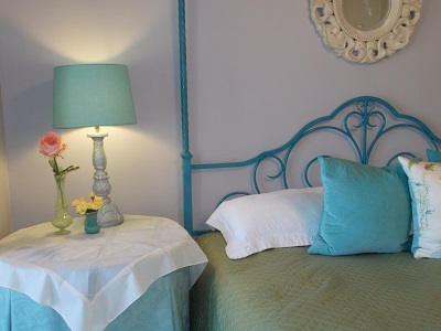 Painted headboard adds a pop of color.