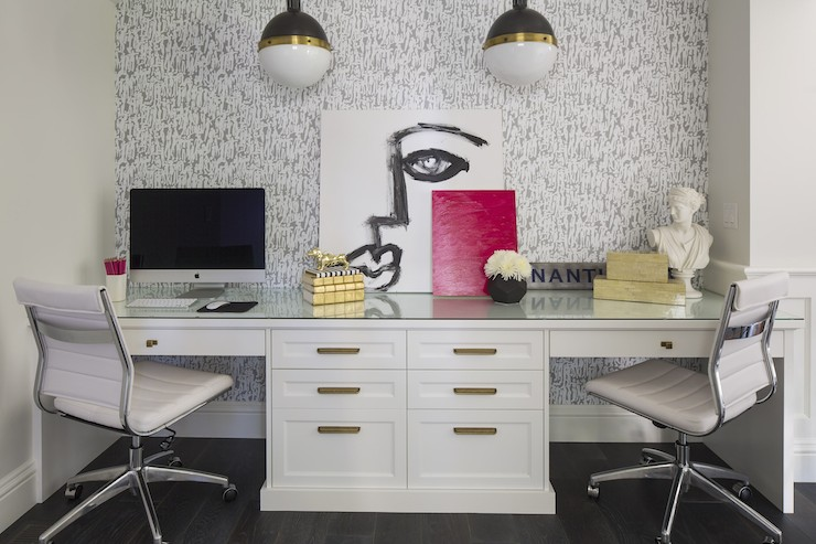 Large desk area in white with bright accents.