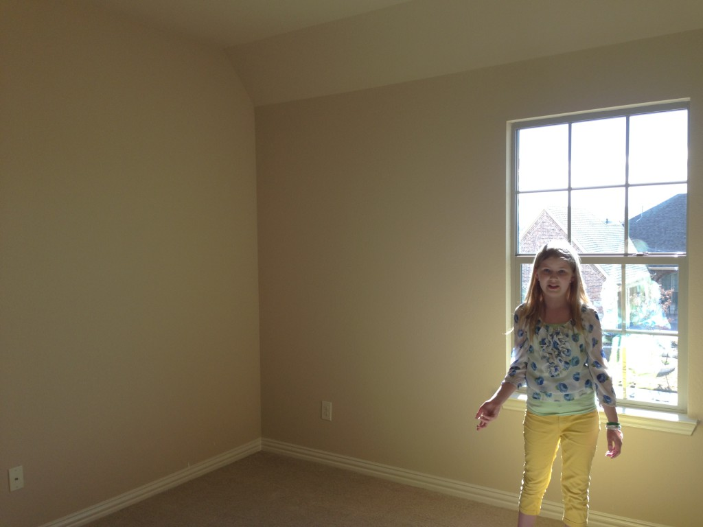 Tabitha in her new room.  To her right on the side wall is where the builder added a door to the plant ledge.