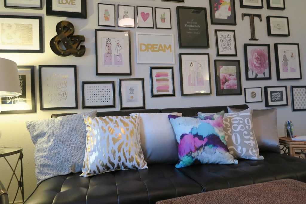 Close up of picture wall with sofa.