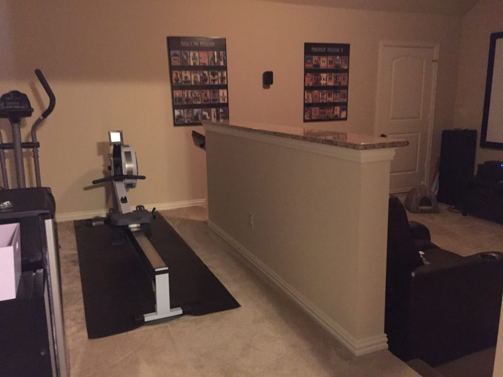 Media Room half wall and workout equipment