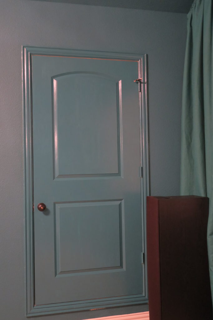 The odd attic door was painted out so it doesn't distract from the movie experience.