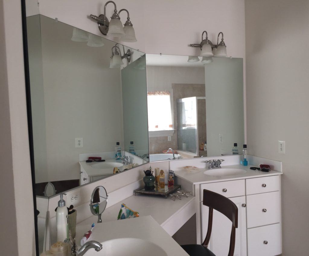 Existing mirrors & sconces.